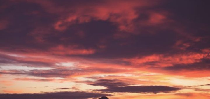 red sky at sunset with mountains