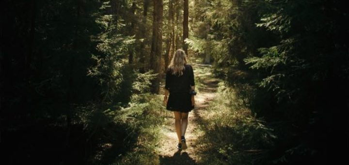 girl walking on a path in a forest
