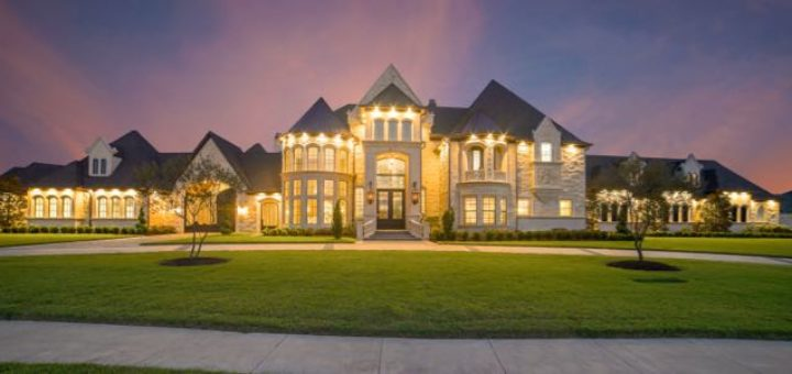 luxury house well lit at night