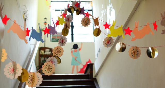 school decorated with paper figures