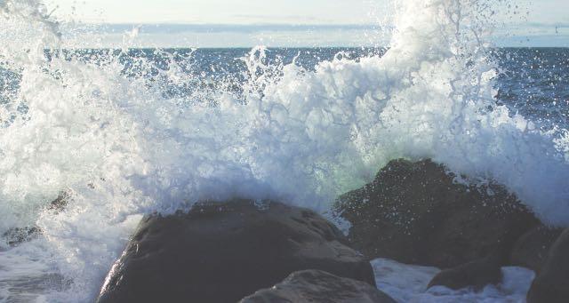 waves crushing over rocks near the sea shore