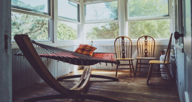 sunroom with chairs and hammock