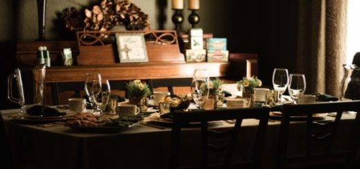 table set for dinner with plates and glasses