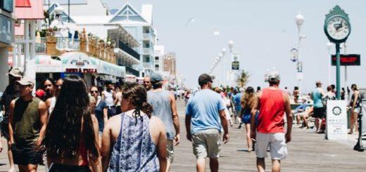 crowded boardwalk on a sunny day