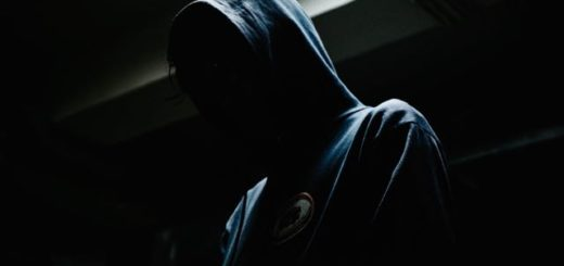 a person in a blue hoody covered in darkness