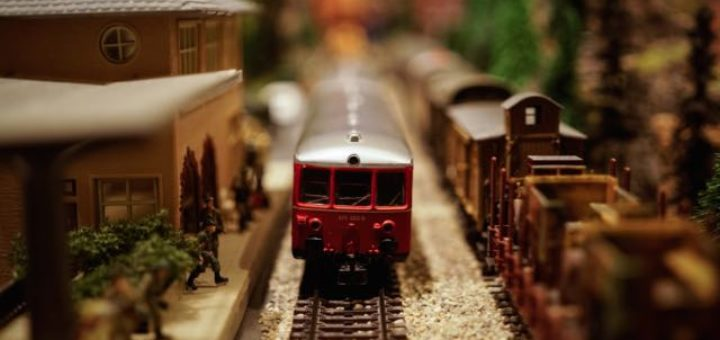 miniature train arriving at the station