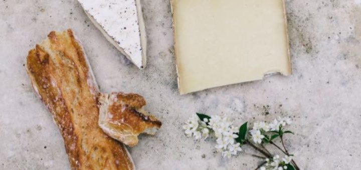 manchego brie and baguette on a table