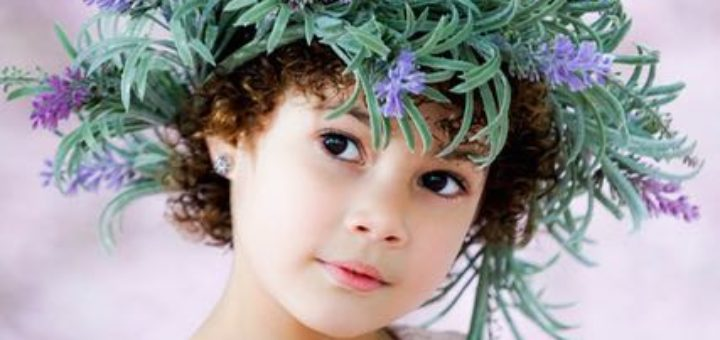 little girl a flower wreath on her head
