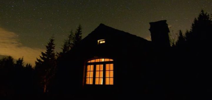 house exterior at night with starry sky