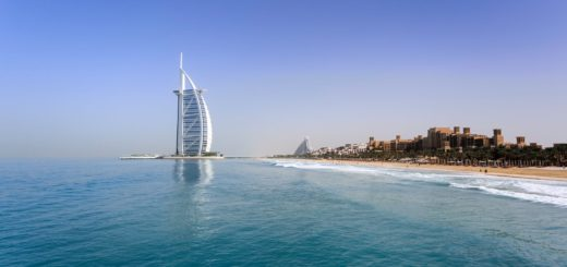 burj kalifa with a stretch of beach in Dubai