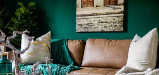 couch in a living room with green walls