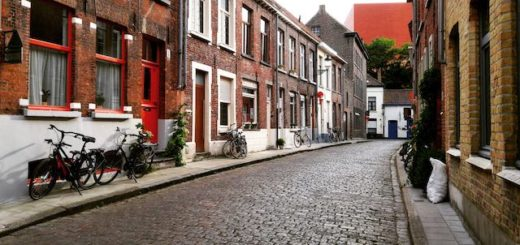 narrow streets Bruge with bicycles and cobble stones